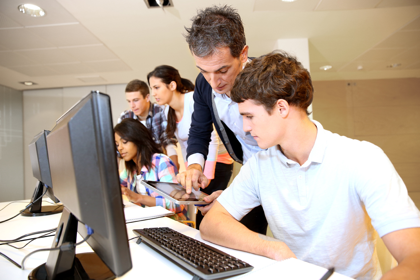 LR-bigstock-Adult-man-helping-student-in-c-41142097